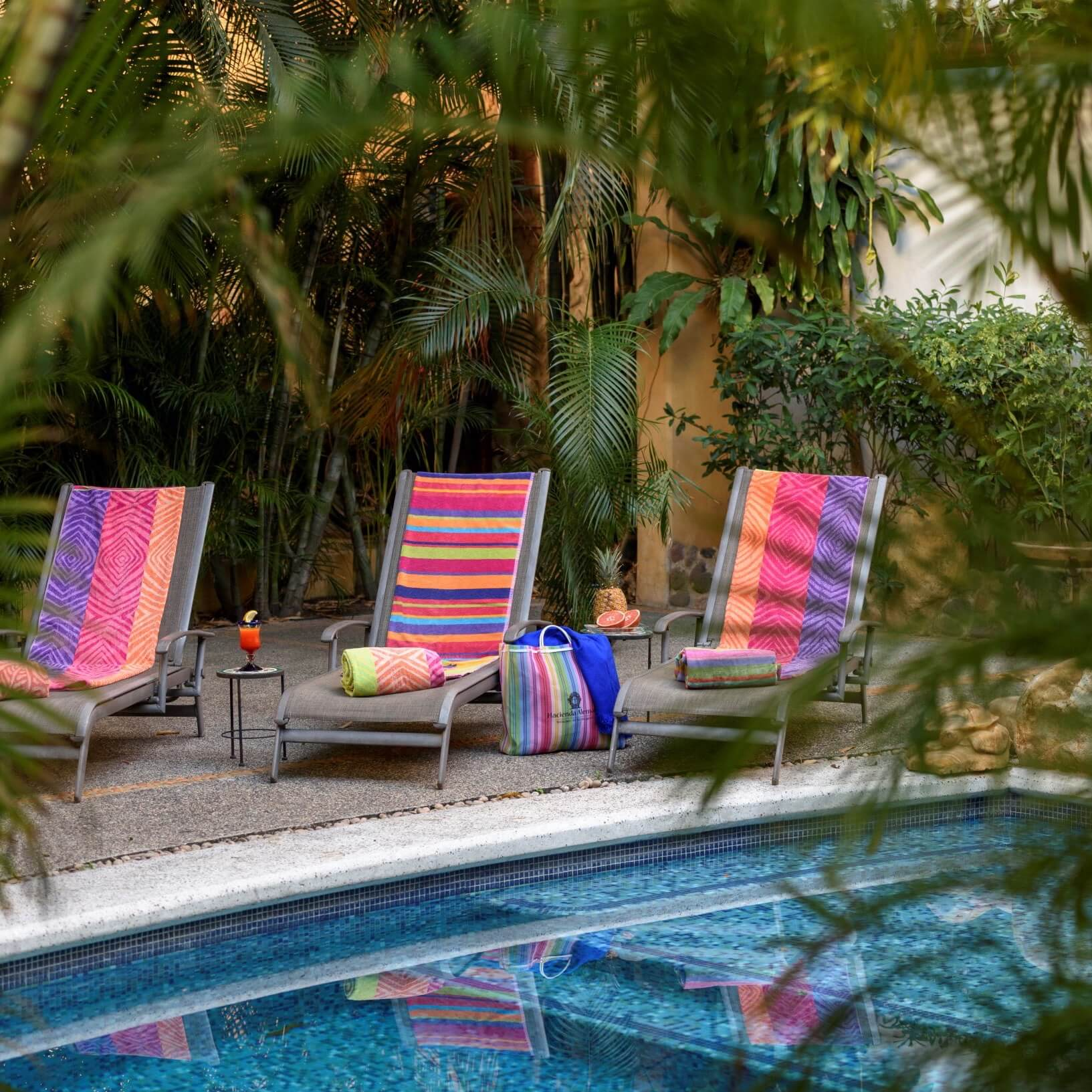 Three lounge chairs by the poolside