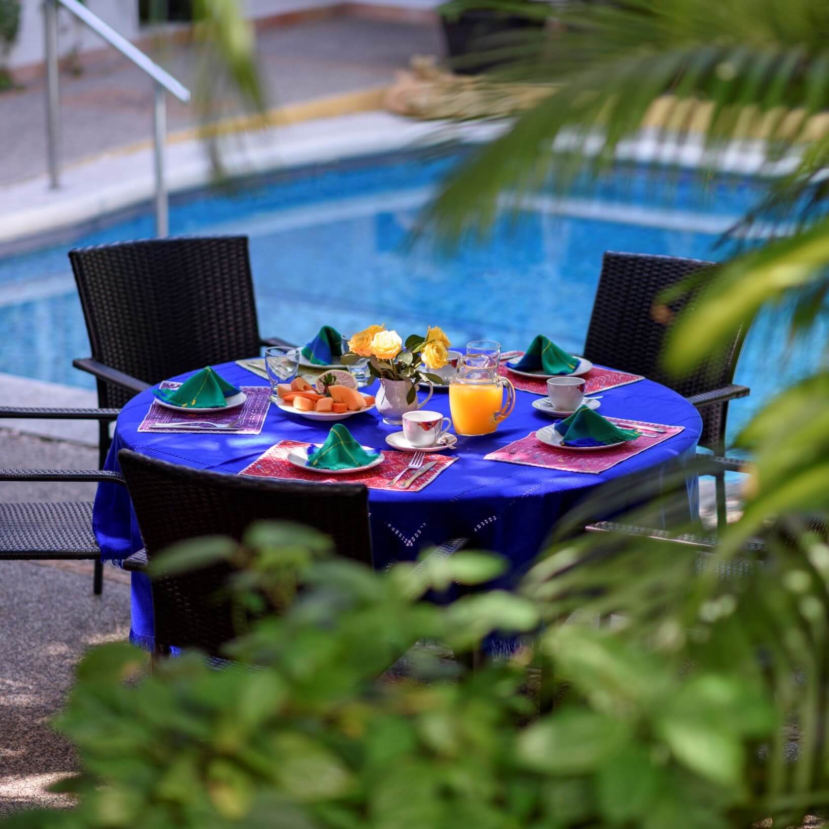 A breakfast table set by the poolside