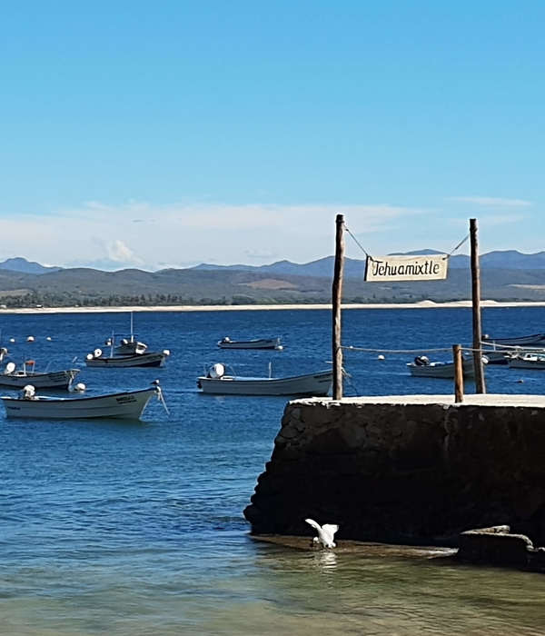 View of boats anchored off of Tehuamixtle dock