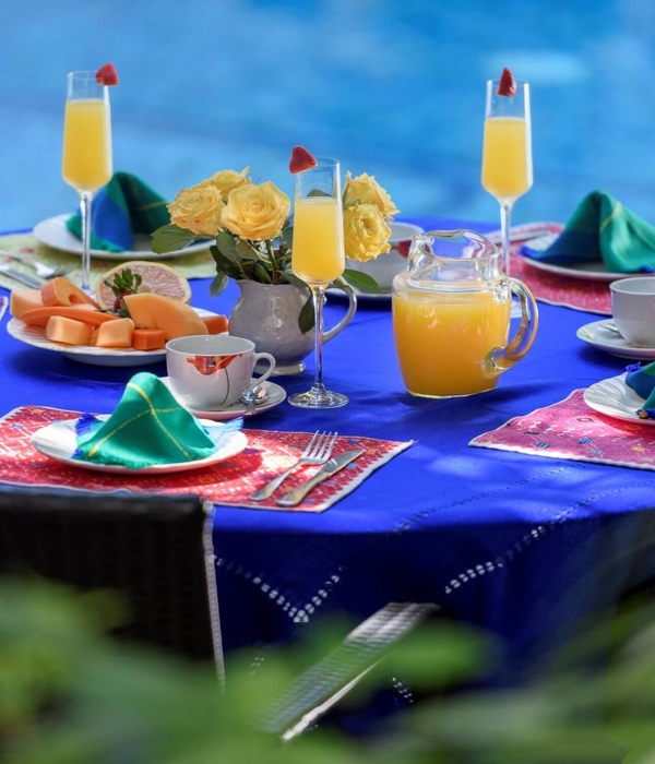 A table set for breakfast at Hacienda Alemana's poolside